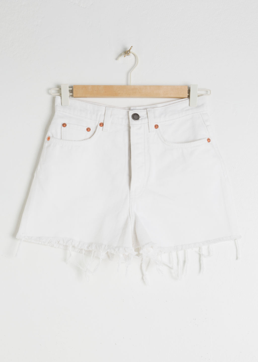 Front image of Stories raw edge denim shorts in white