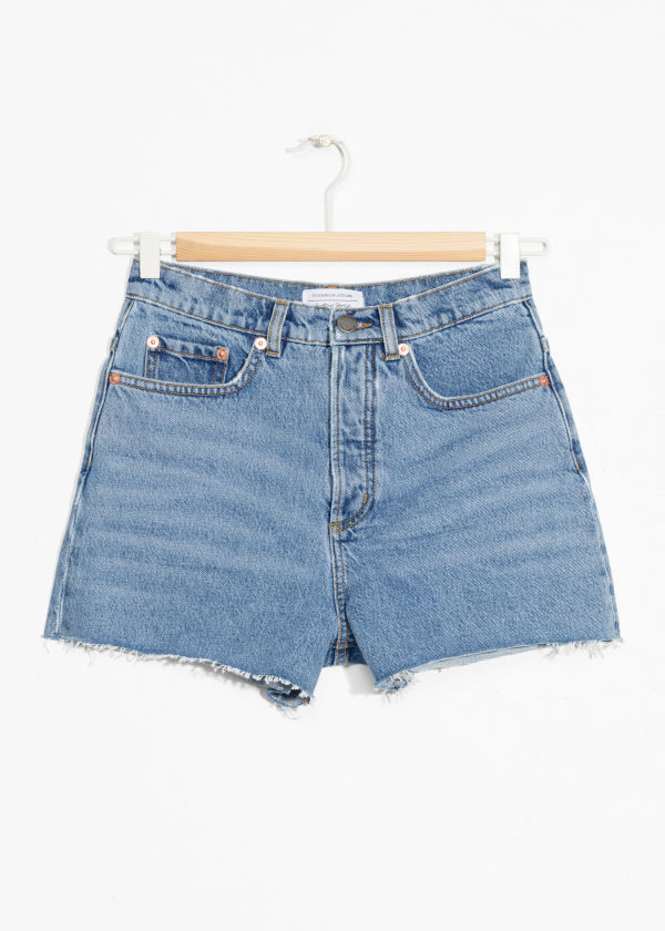 Front image of Stories raw edge denim shorts in blue