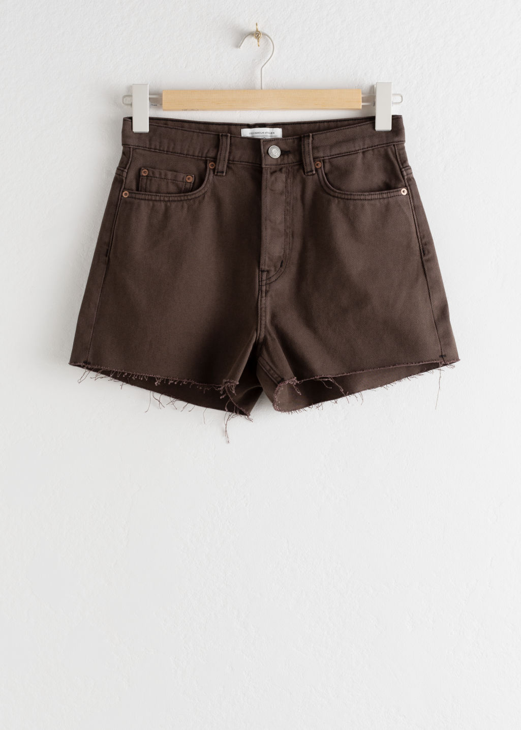 Front image of Stories raw edge denim shorts in brown