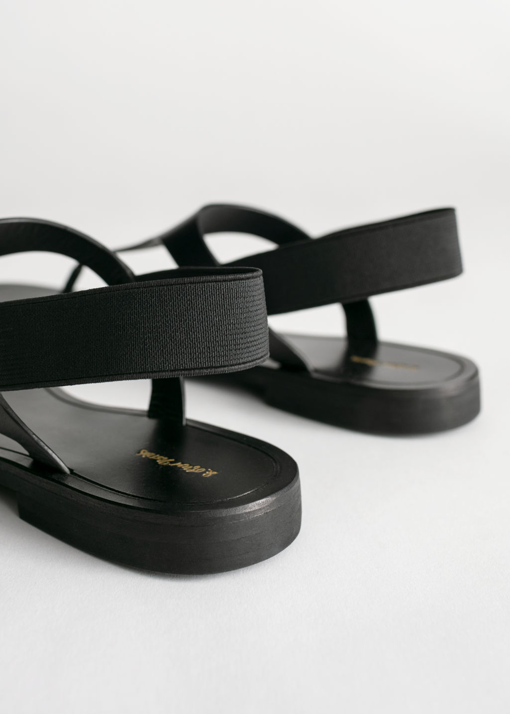 Back image of Stories leather t-bar strap sandals in black