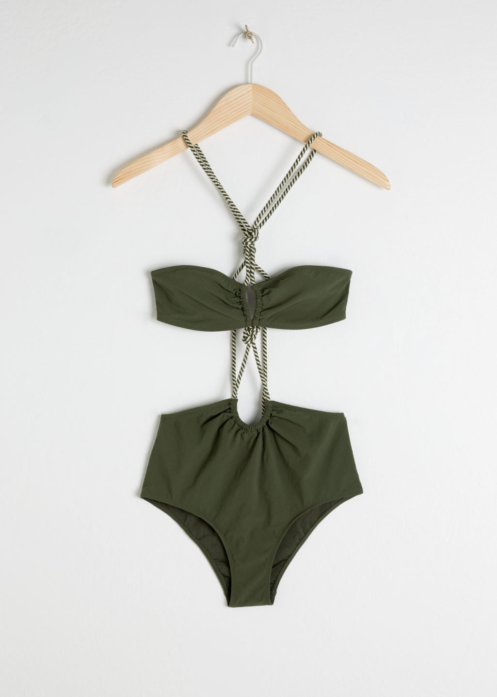 Front image of Stories open twisted rope swimsuit in green