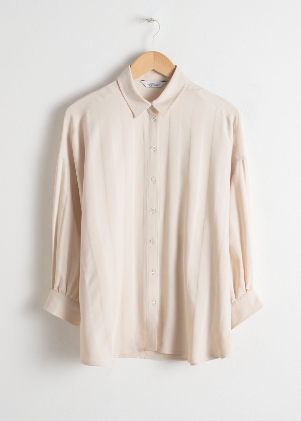 Front image of Stories striped jacquard lounge shirt in beige