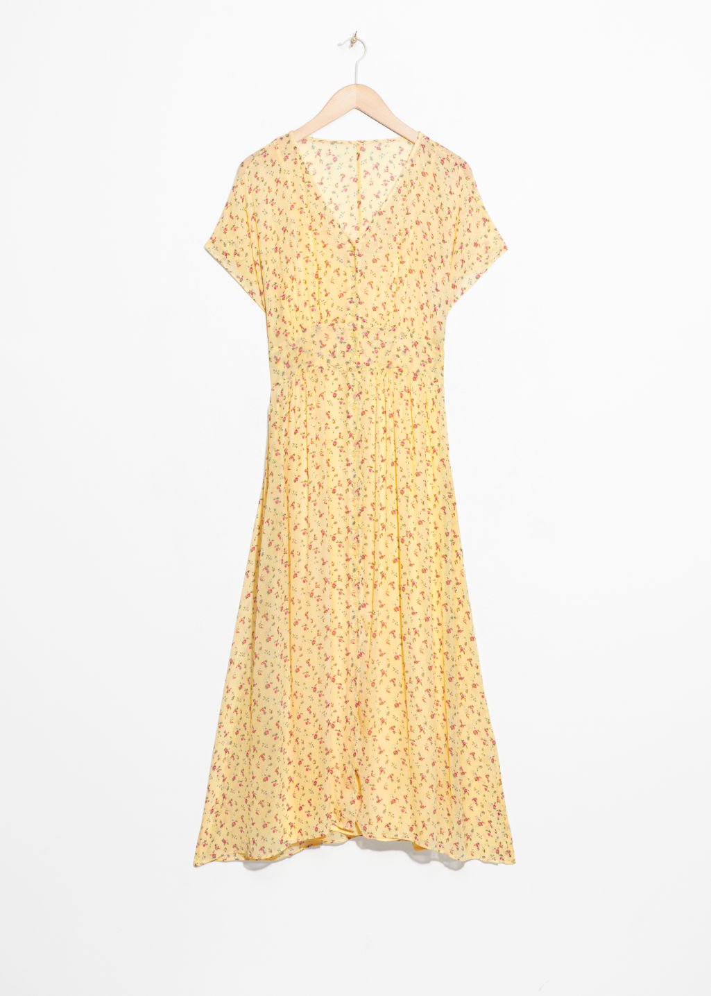 Front image of Stories floral print midi dress in yellow