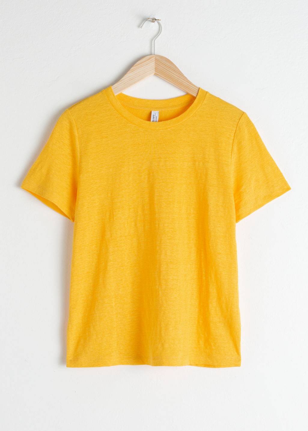 Front image of Stories classic crewneck tee  in yellow