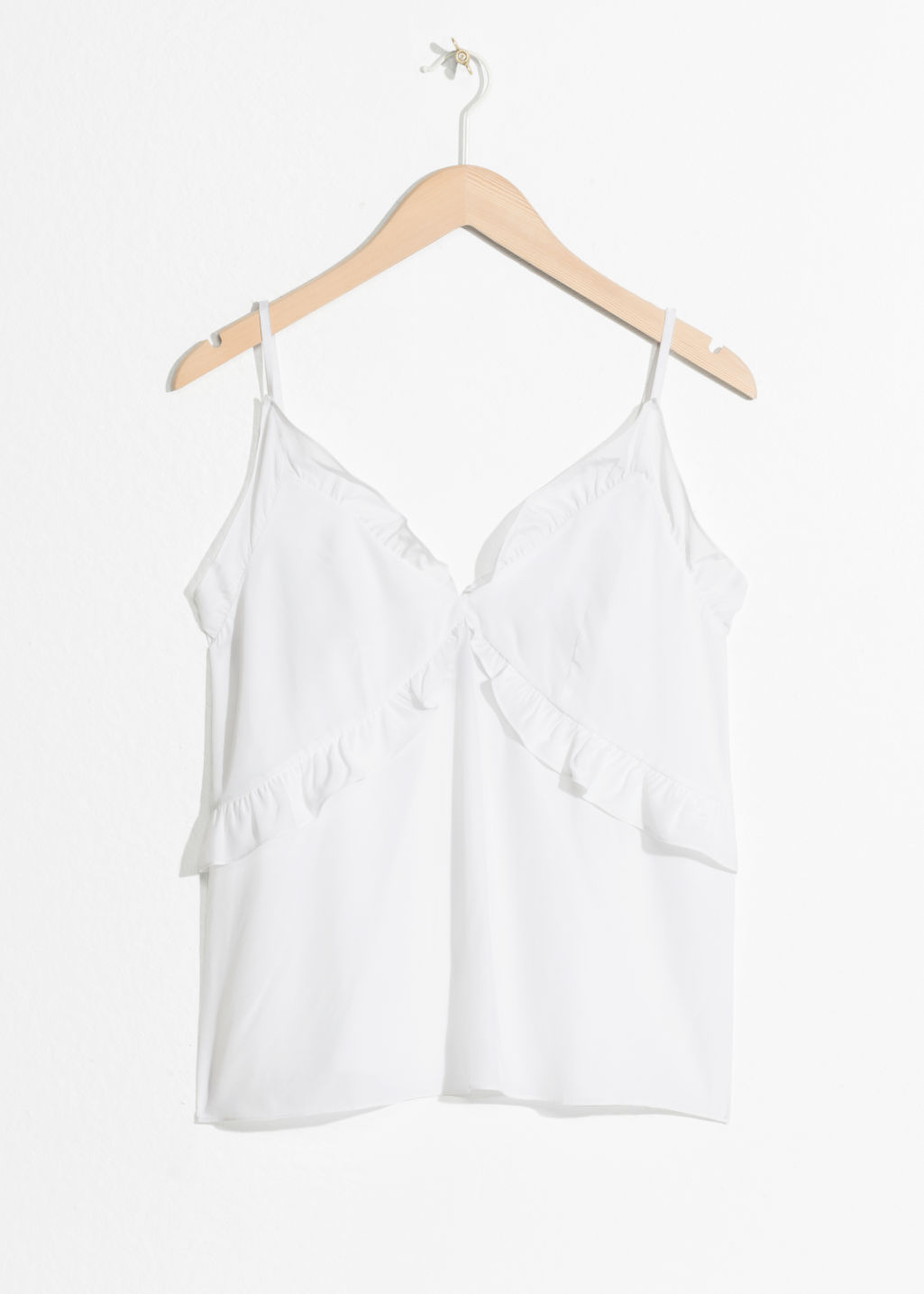 Front image of Stories ruffled tank top in white
