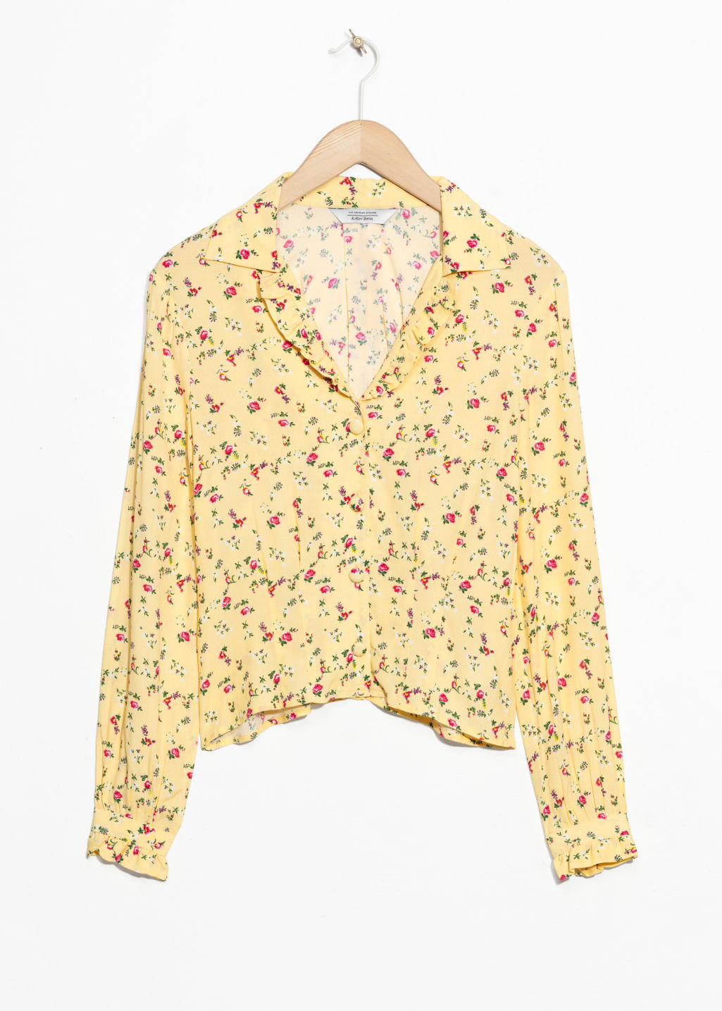 Front image of Stories printed ruffle collar blouse  in yellow