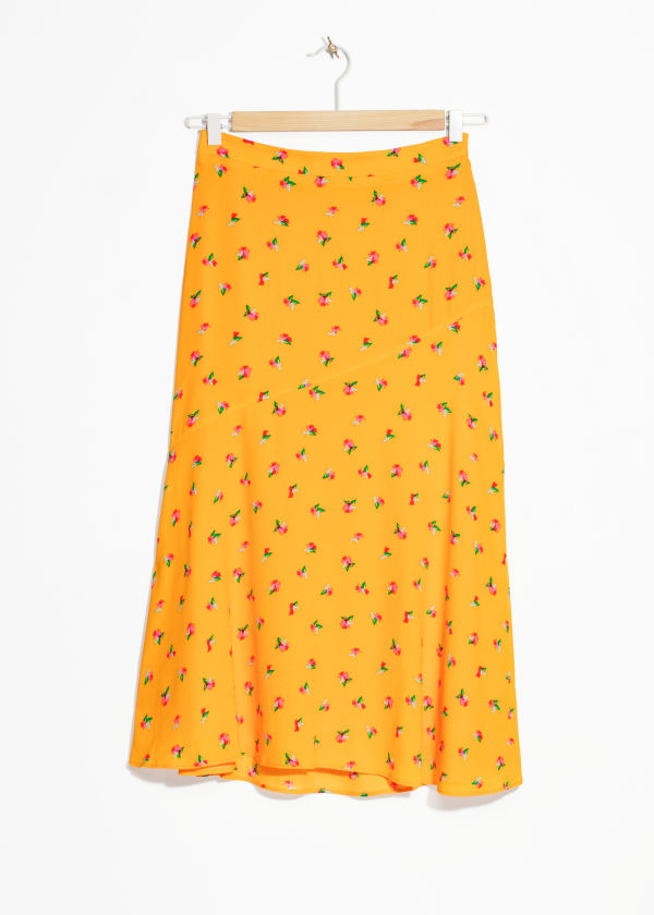 Front image of Stories asymmetrical floral midi skirt in yellow