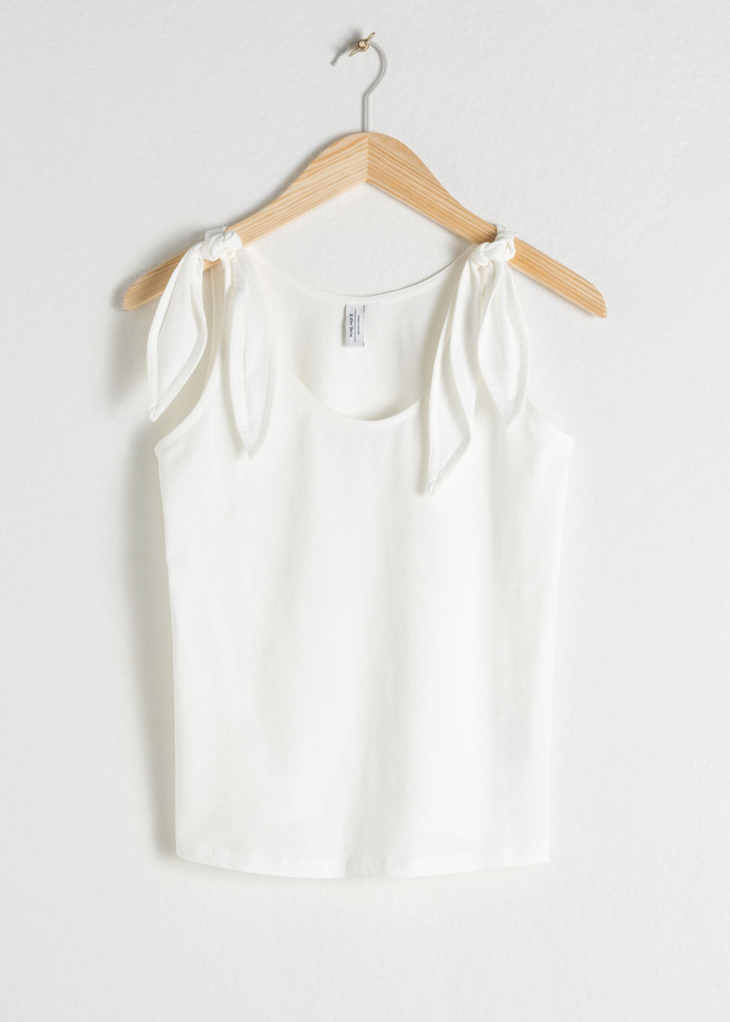 Front image of Stories tie tank top in white
