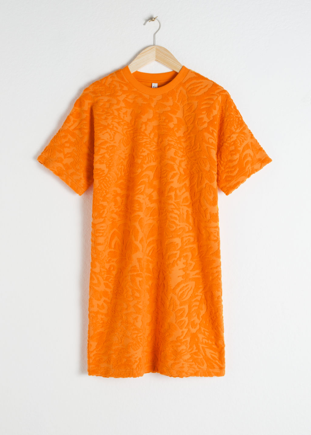 Front image of Stories velour t-shirt dress in orange
