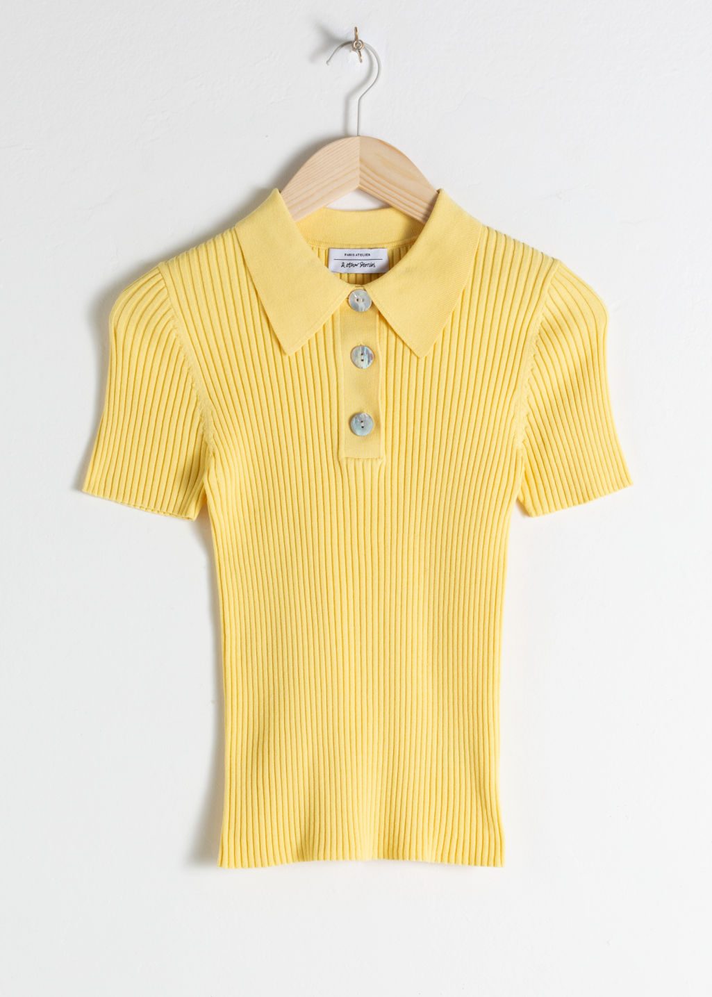 Front image of Stories knit polo top  in yellow