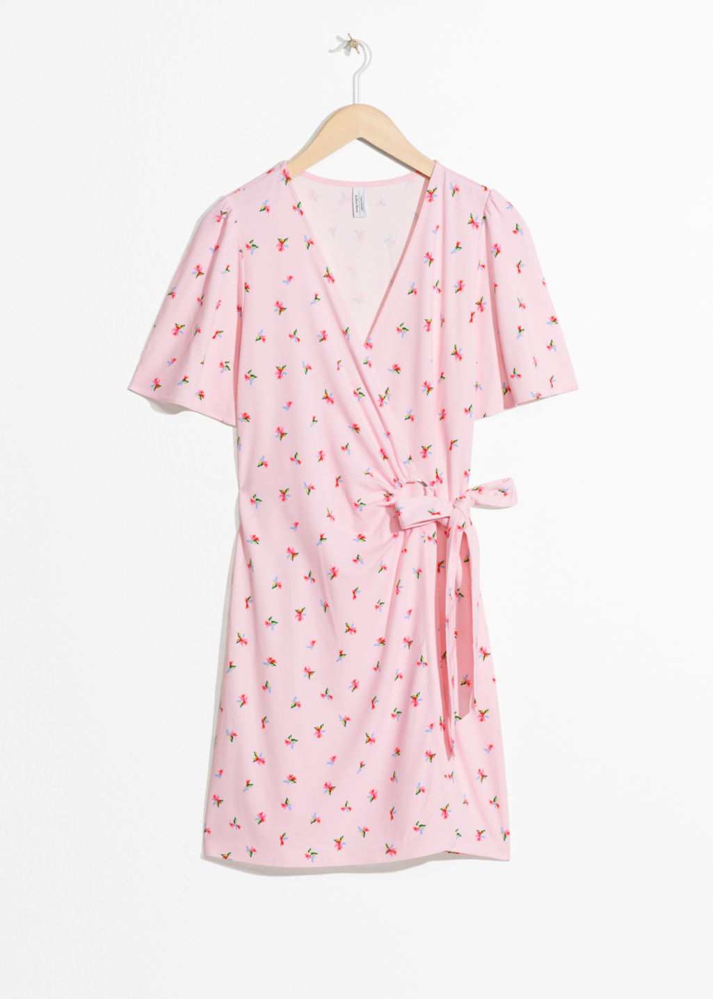 Front image of Stories tropical flower wrap dress in pink