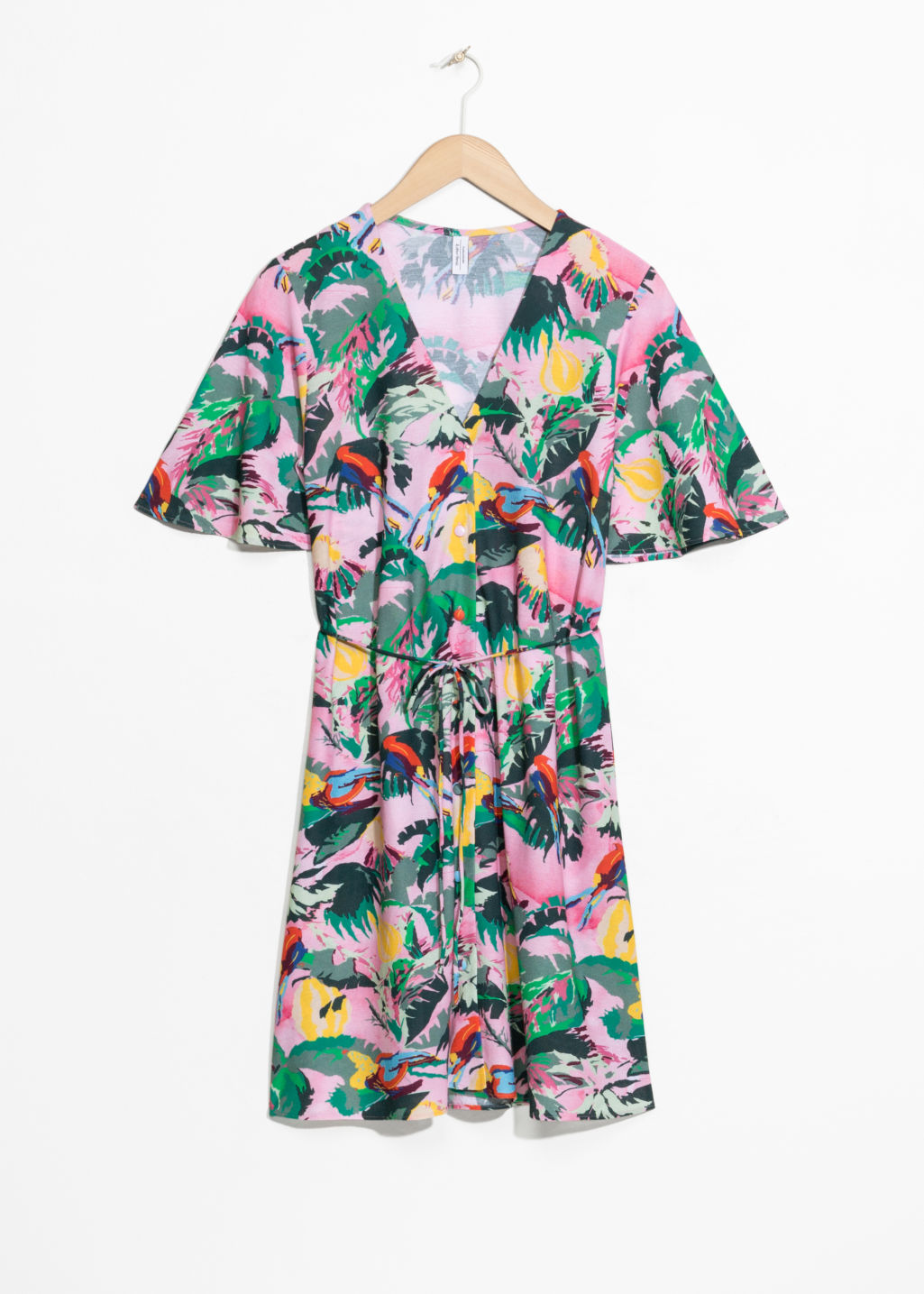 Front image of Stories tropical print dress in pink