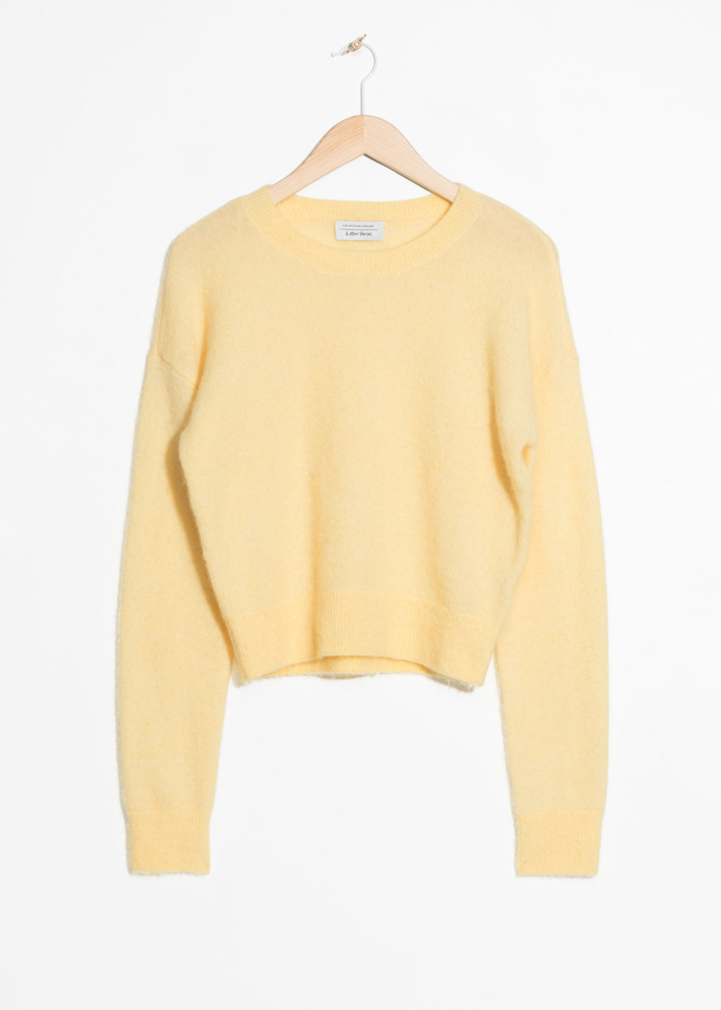 Front image of Stories fuzzy sweater in yellow