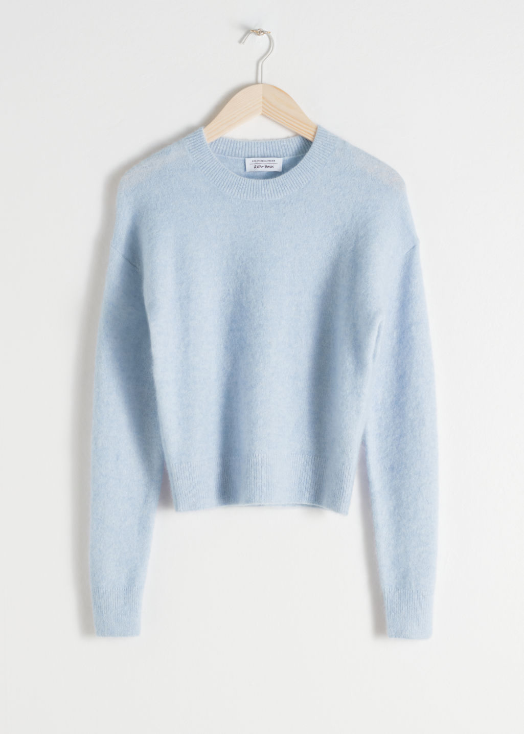 Front image of Stories fuzzy sweater in turquoise
