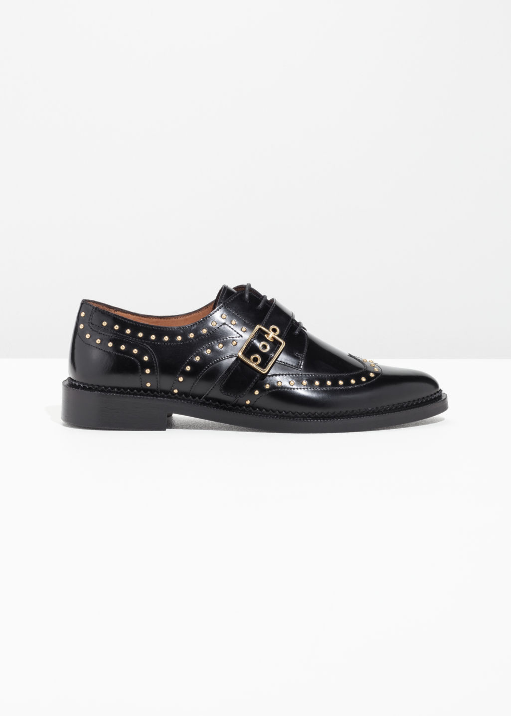 Front image of Stories buckle studded brogues in black