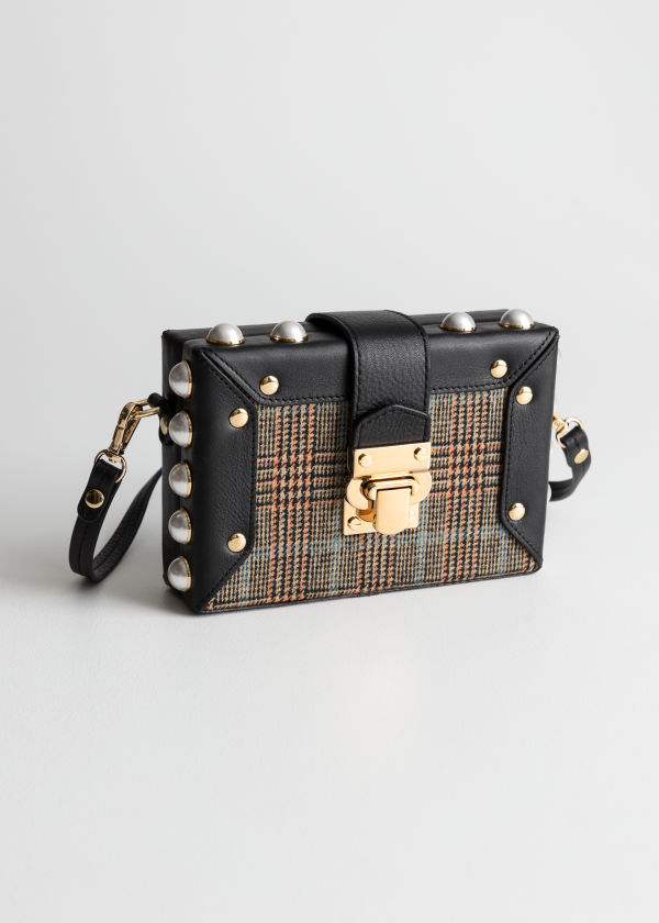 Front image of Stories structured pearl framed crossbody in black