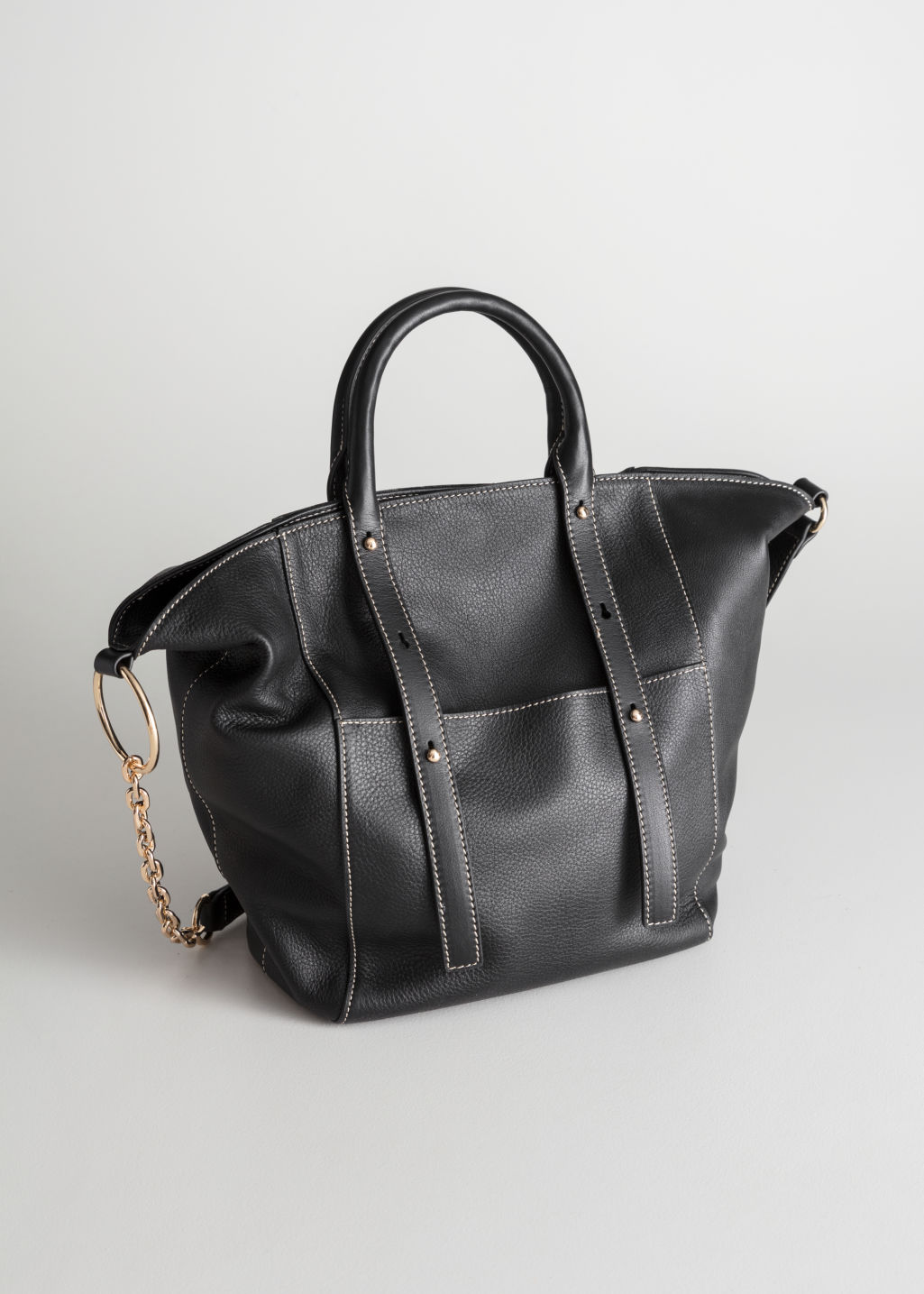 Front image of Stories large leather tote bag in black
