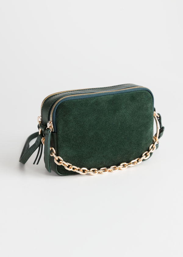 Front image of Stories o-ring chain crossbody bag in green