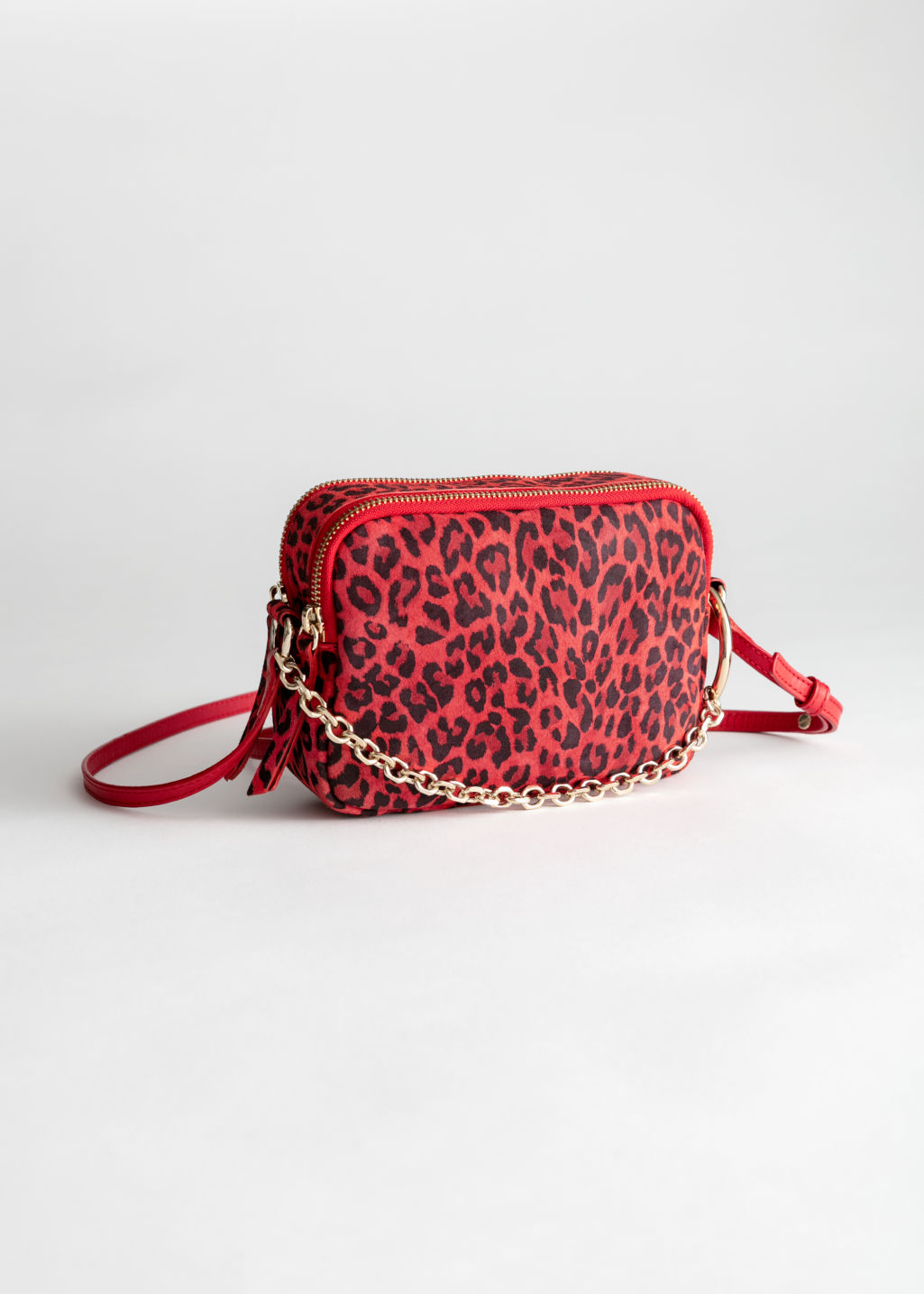 Front image of Stories o-ring chain crossbody bag in red