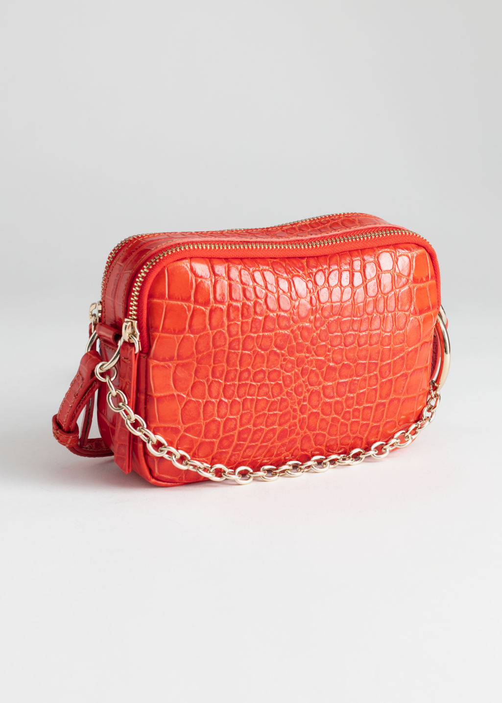 Front image of Stories o-ring chain crossbody bag in orange