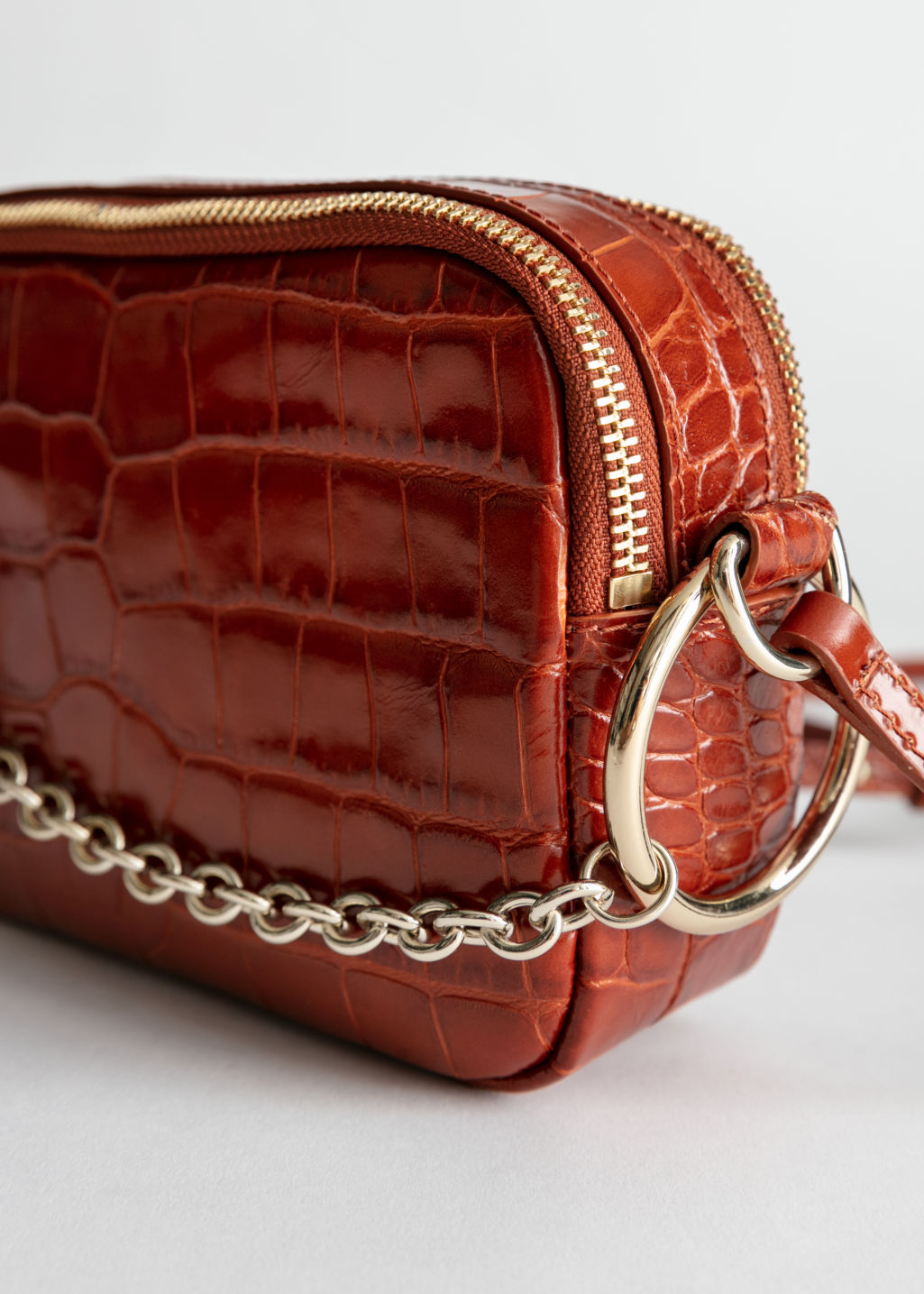 Back image of Stories o-ring chain crossbody bag in orange
