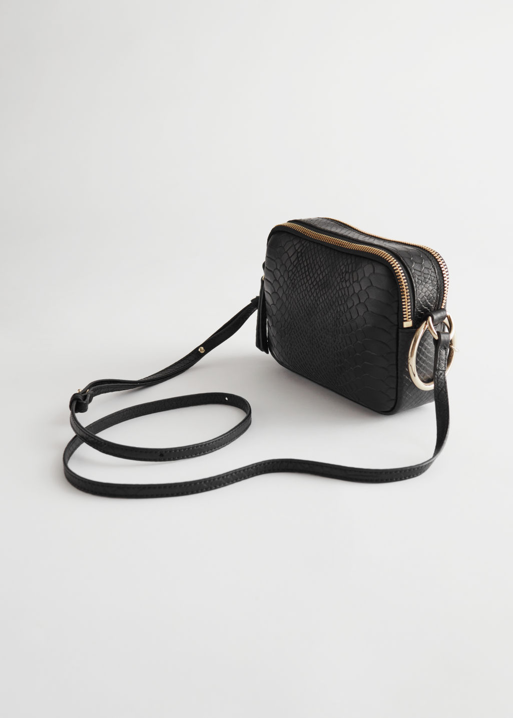 Back image of Stories o-ring chain crossbody bag in black
