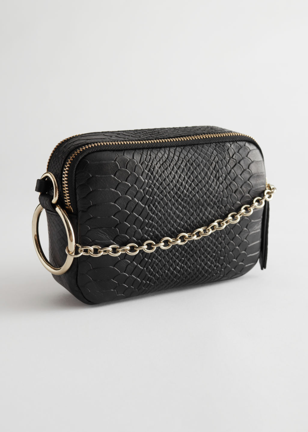 Front image of Stories o-ring chain crossbody bag in black