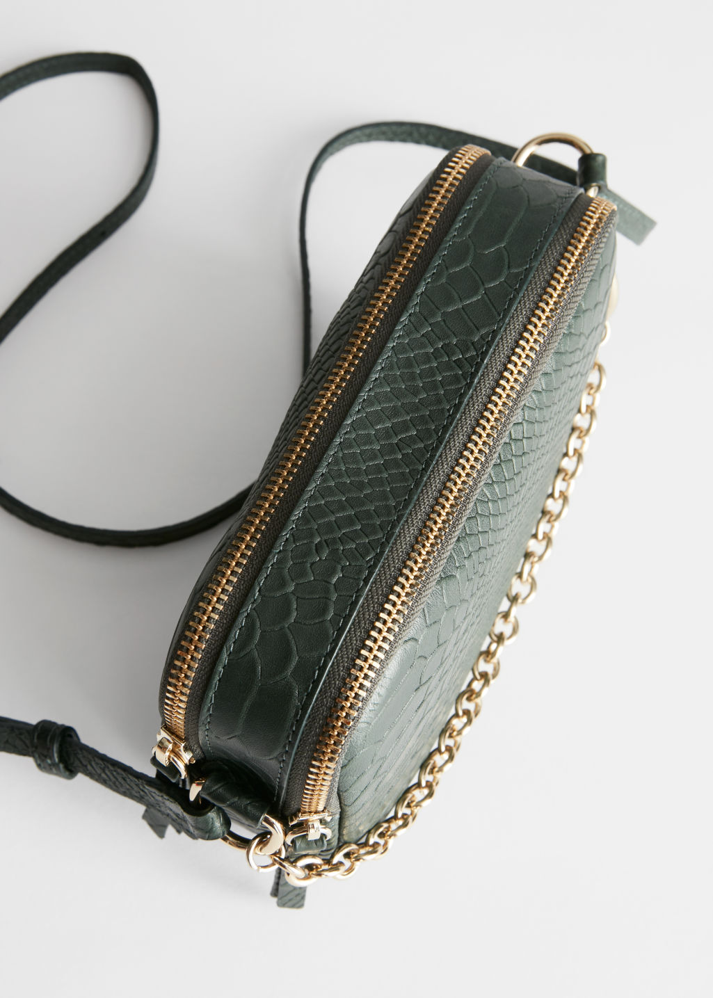 Side image of Stories o-ring chain crossbody bag in green