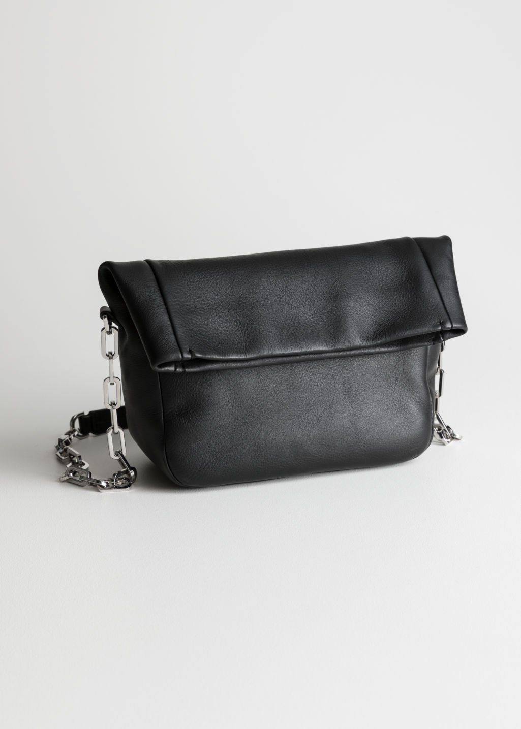 Front image of Stories fold over leather bag in black