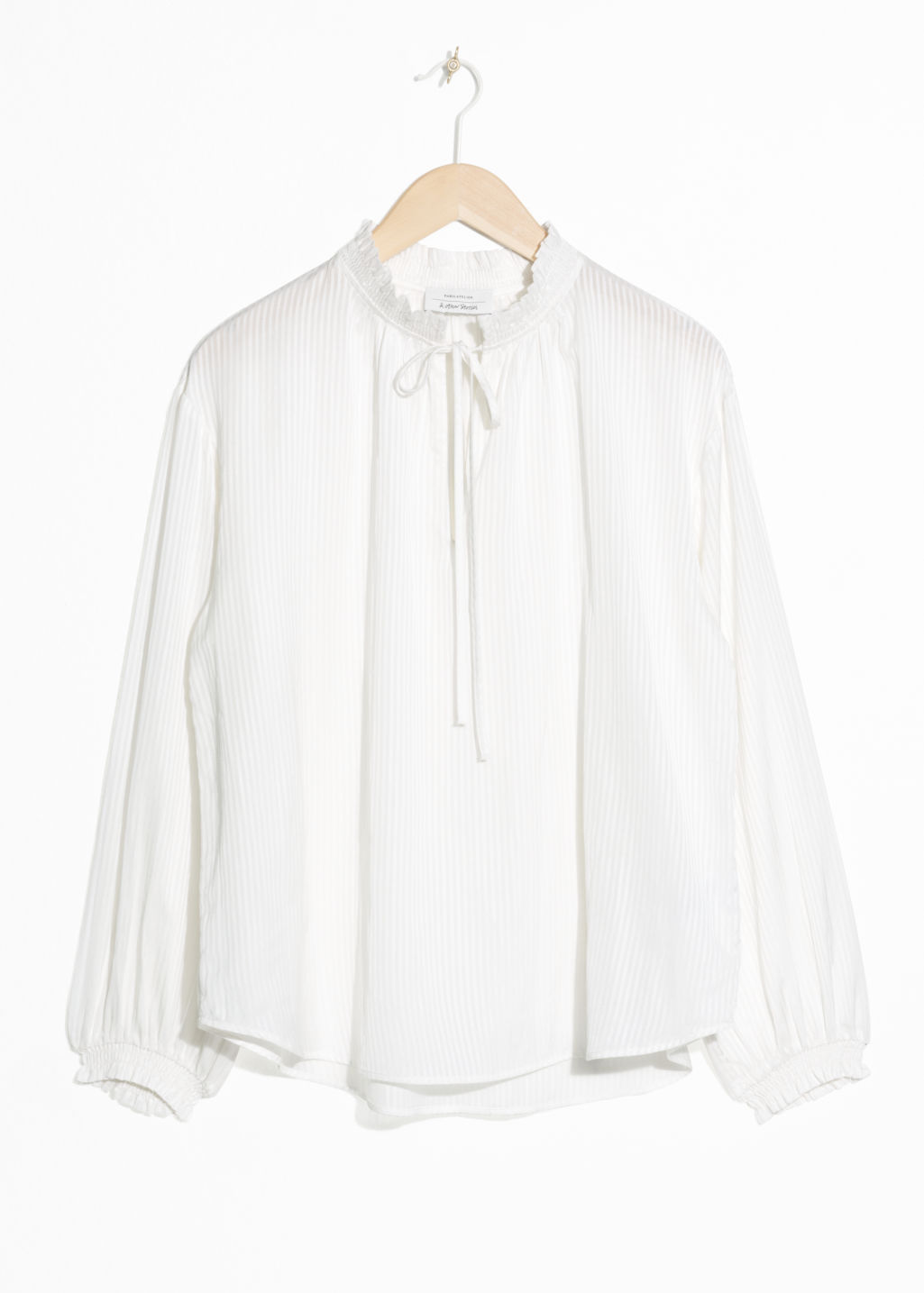 Front image of Stories billowy tie neck blouse  in white