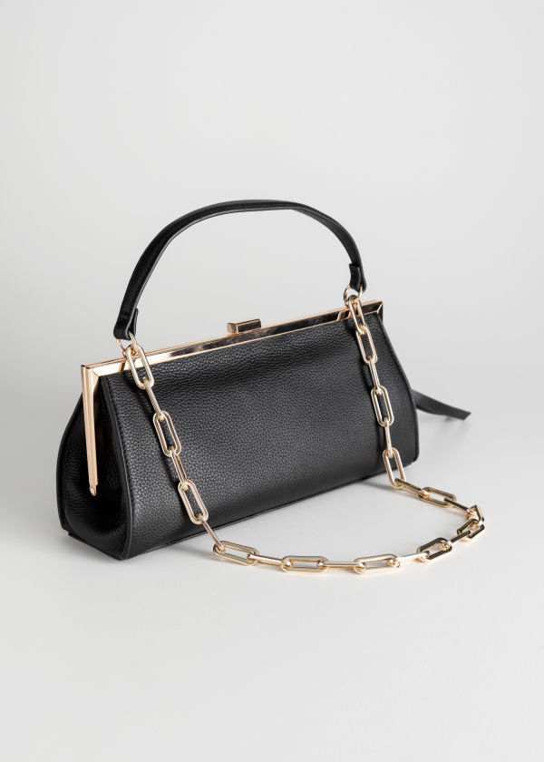 Front image of Stories grainy leather chain small bag in black