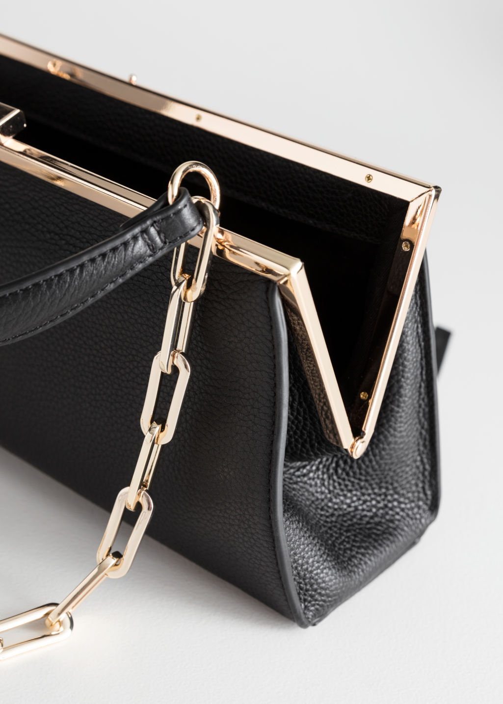 Back image of Stories grainy leather chain small bag in black