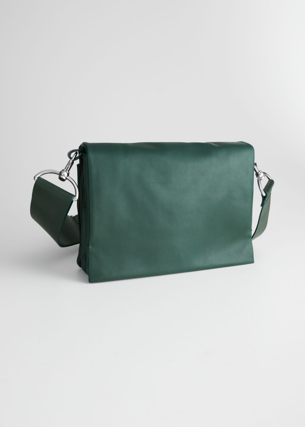 Front image of Stories short utility crossbody bag in green