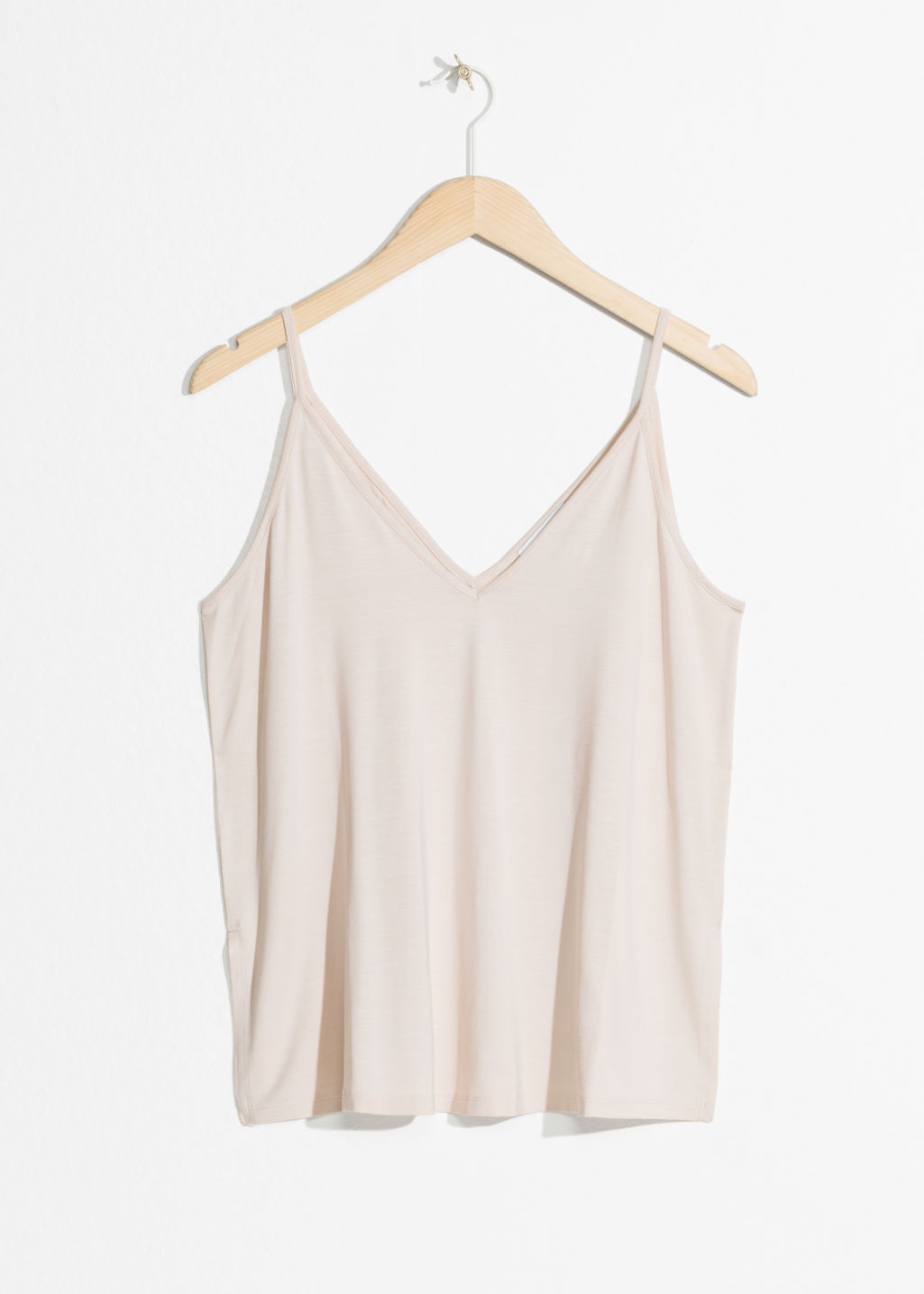 Front image of Stories v cut tank top in beige