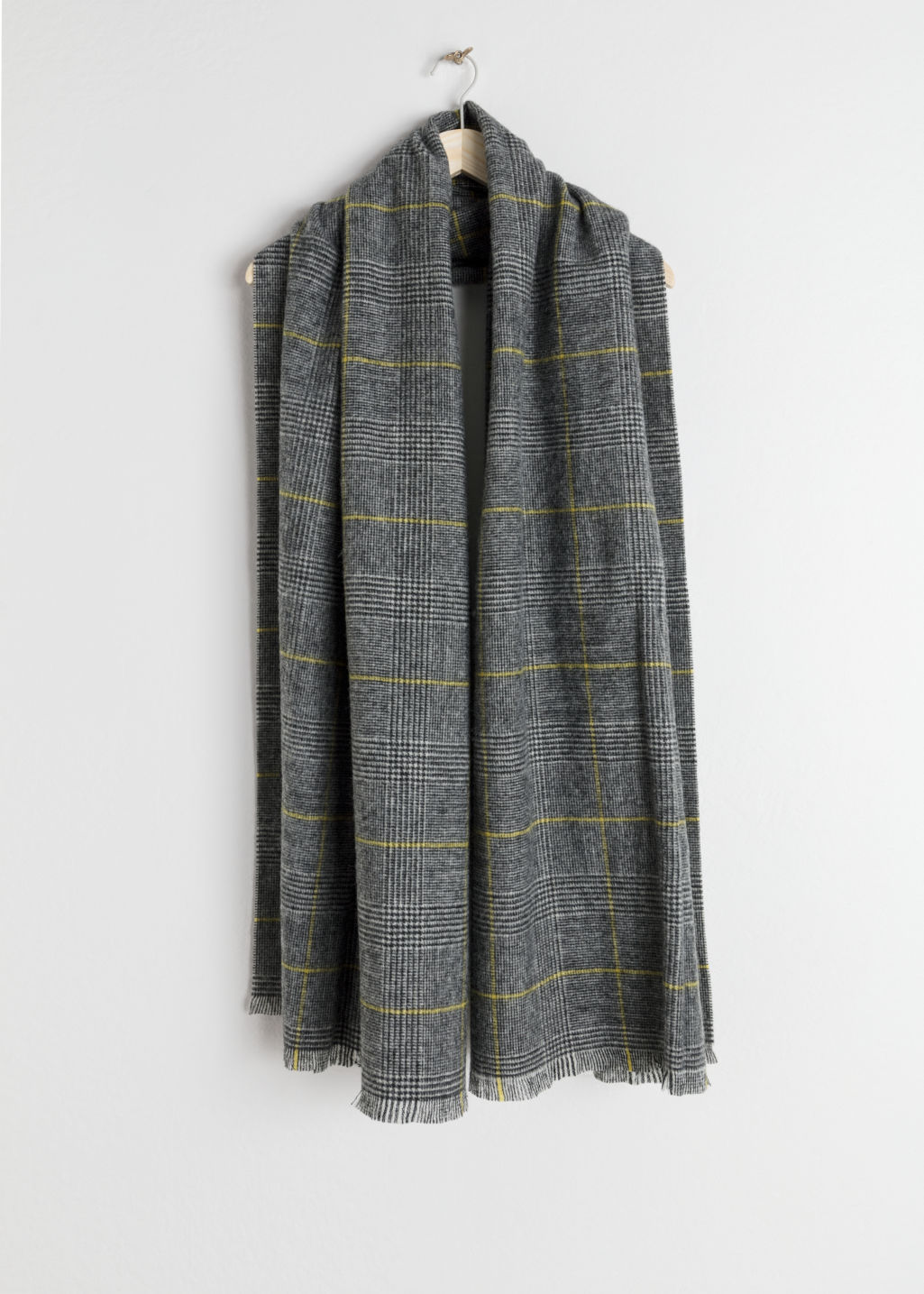 Front image of Stories wool plaid scarf in yellow