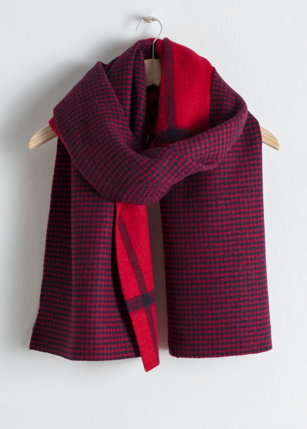 Front image of Stories houndstooth plaid wool scarf in red