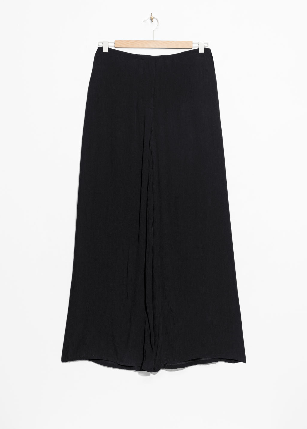 Front image of Stories wide crepe trousers in black