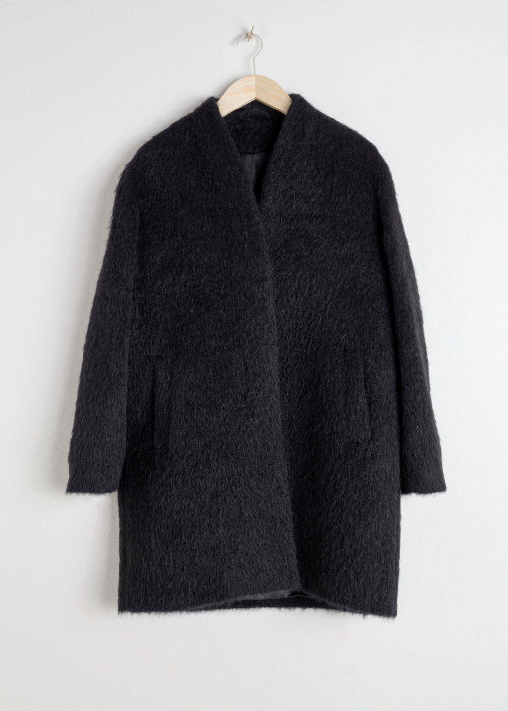 Front image of Stories boxy coat in black