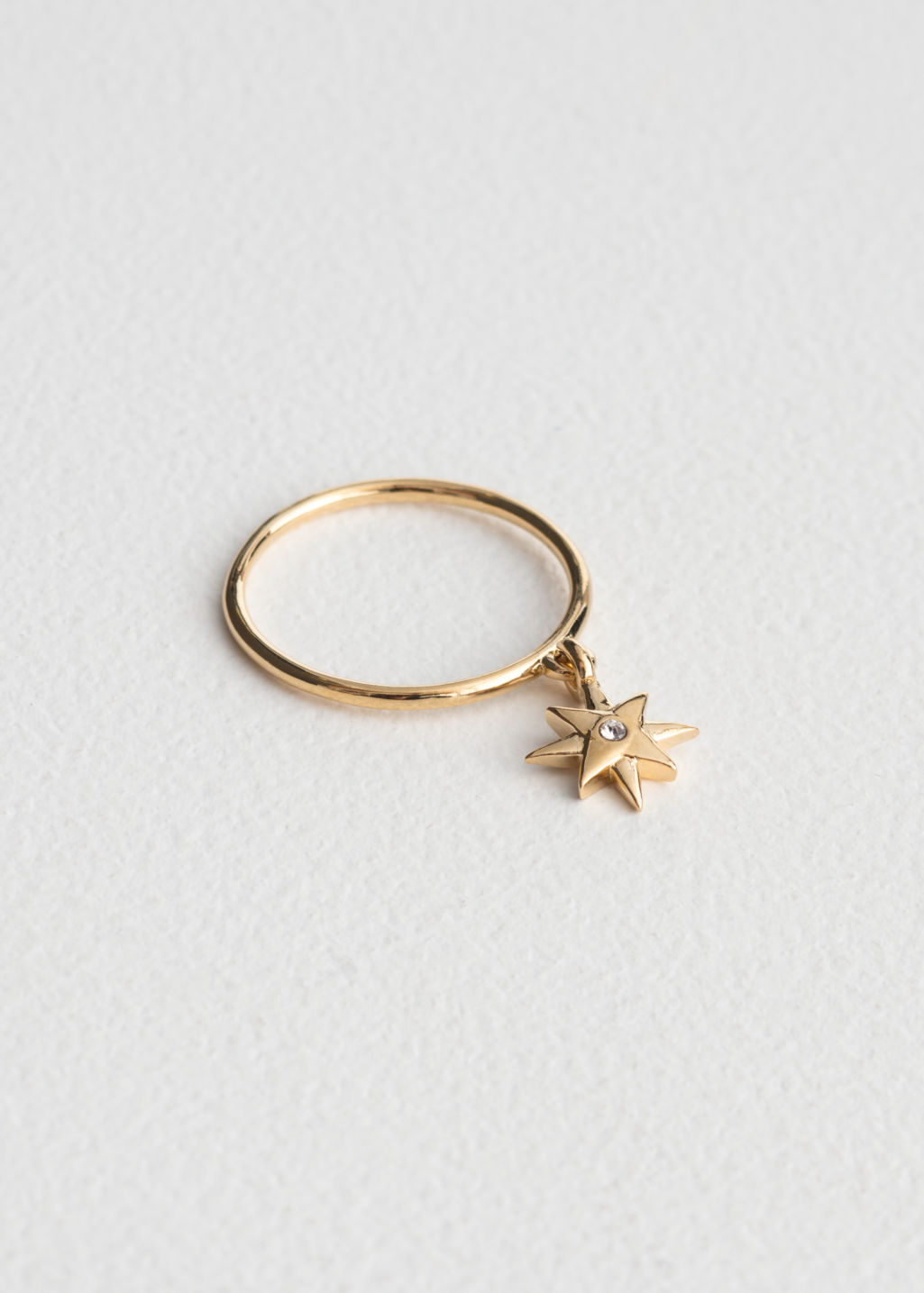 Front image of Stories dangling star charm ring in gold