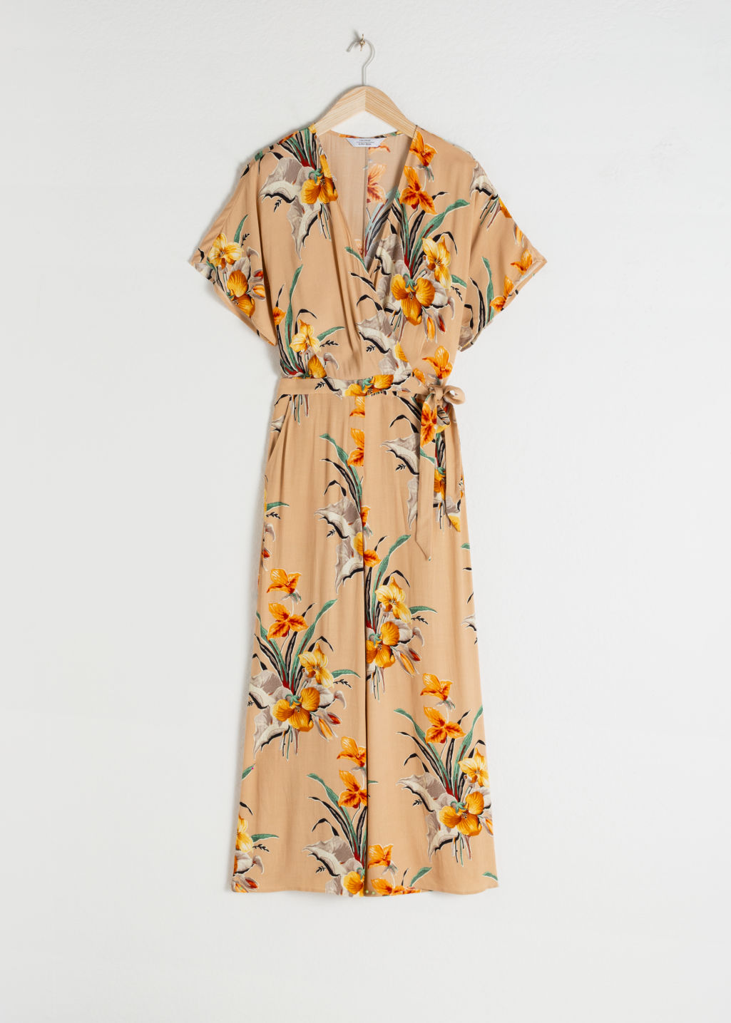 Front image of Stories tropical print wrap jumpsuit  in beige