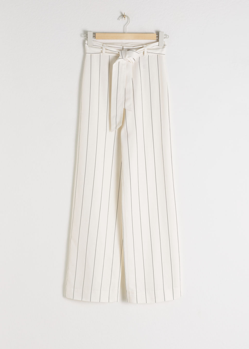 Front image of Stories paperwaist striped trousers in white
