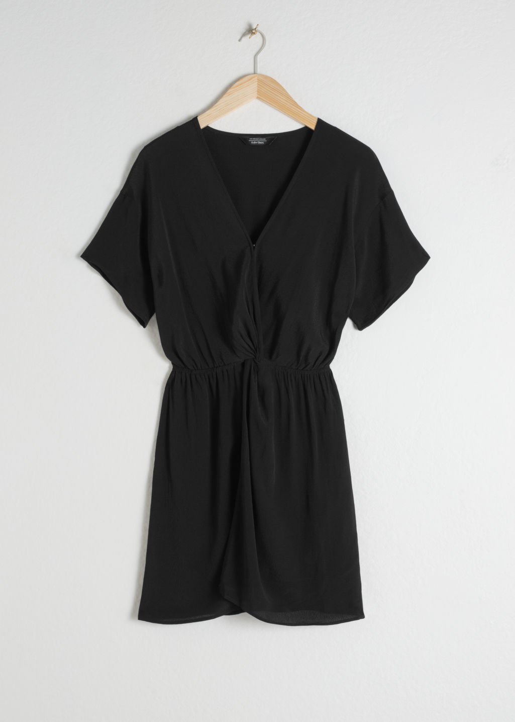 Front image of Stories printed twist knot dress in black