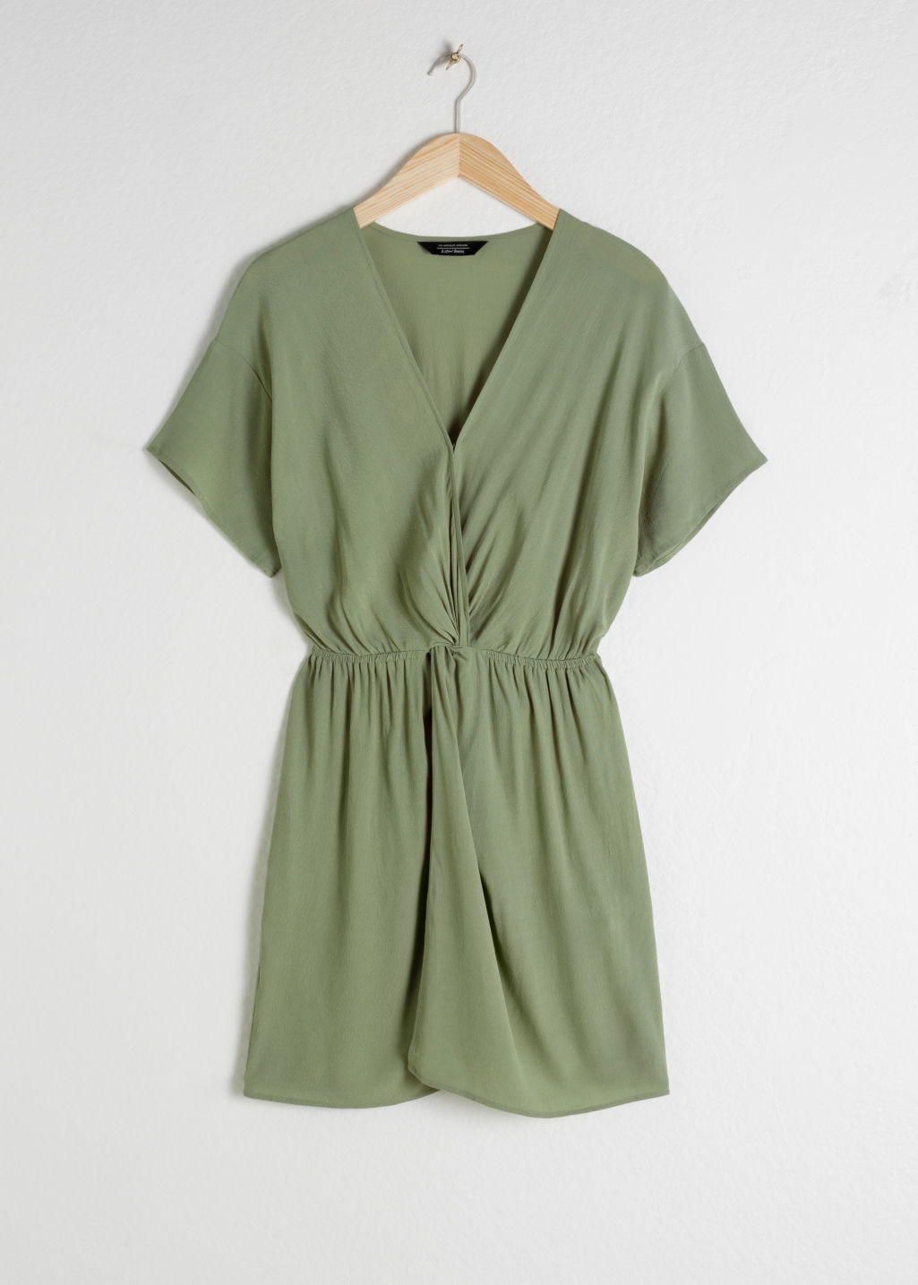 Front image of Stories printed twist knot dress in green
