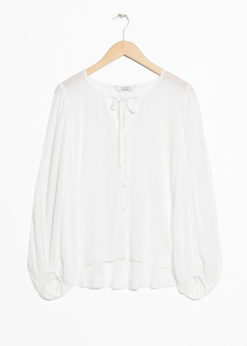 Front image of Stories billowy neck tie blouse  in white