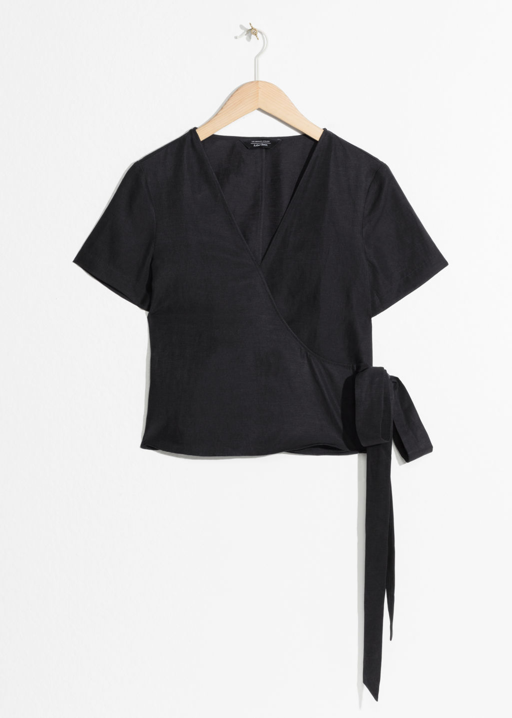 Front image of Stories wrap tie blouse  in black