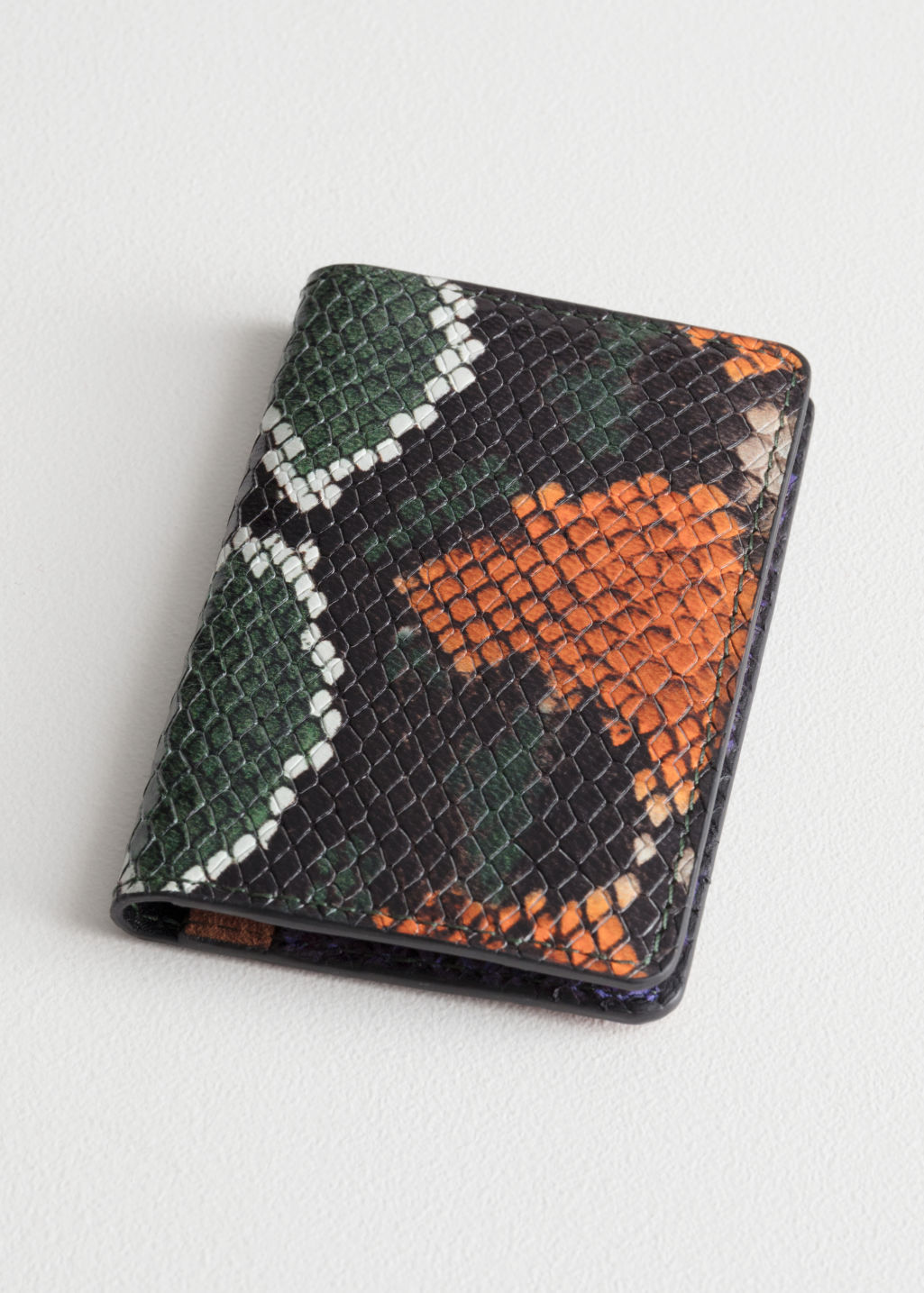 4eee539bde7f Front image of Stories snake embossed leather cardholder in orange ...