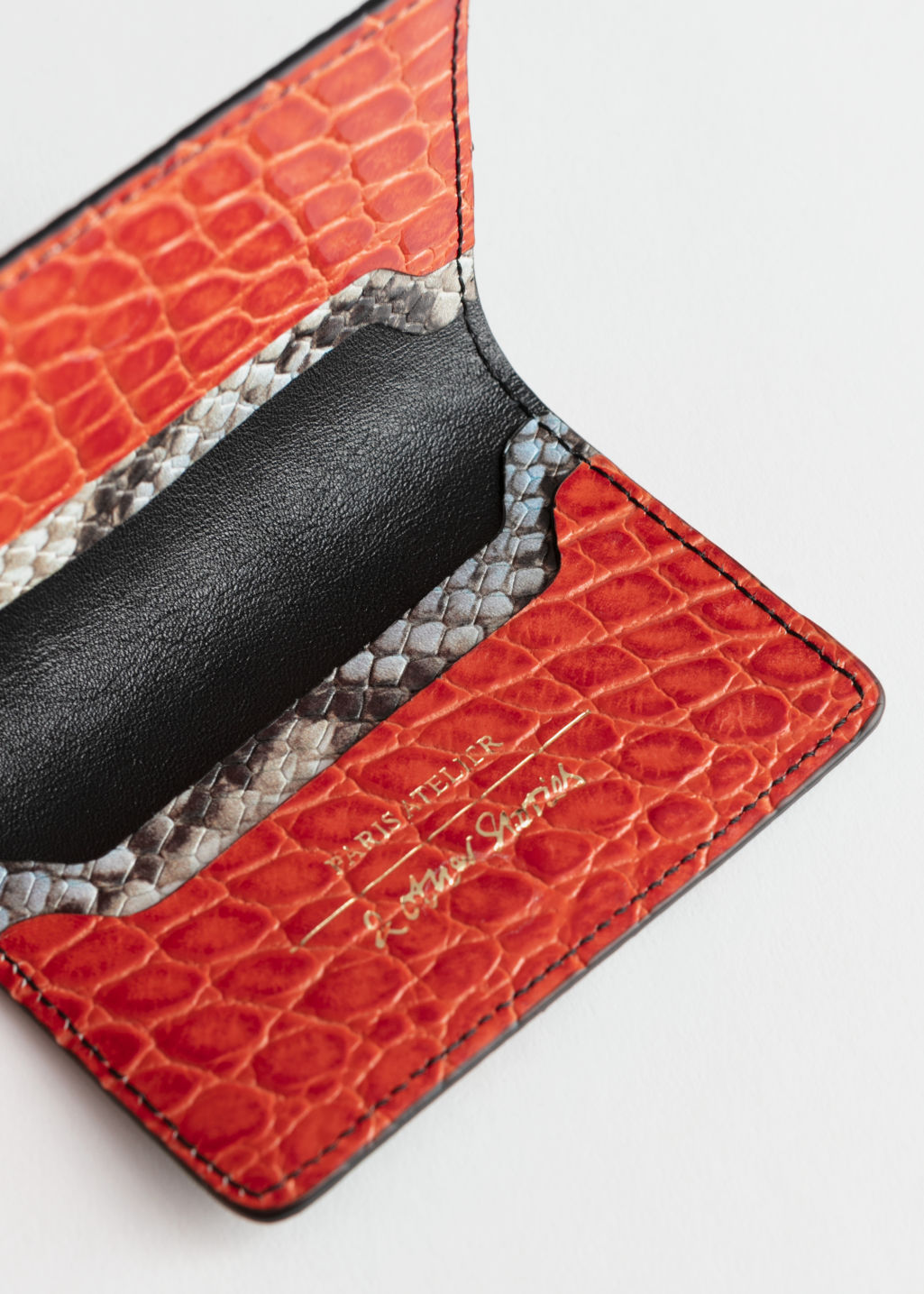 Back image of Stories snake embossed leather cardholder in orange