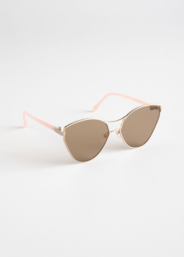 Front image of Stories pointed cutout frame sunglasses in orange