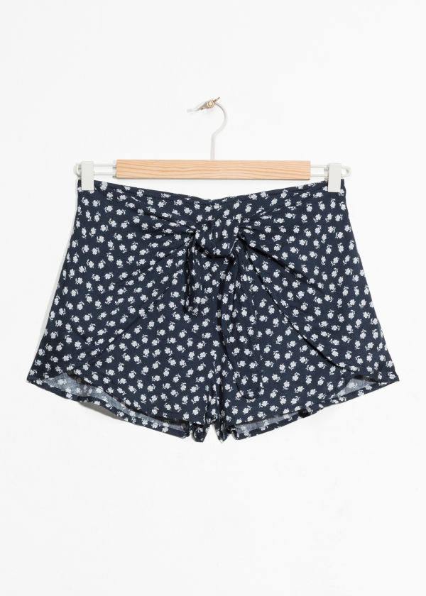 Front image of Stories hibiscus print shorts in blue