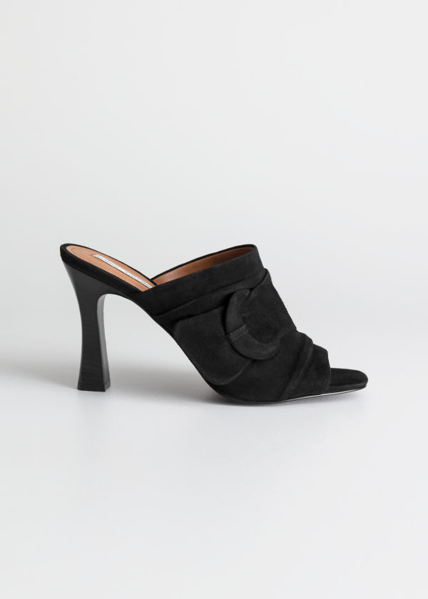 Front image of Stories square buckle open toe mules in black